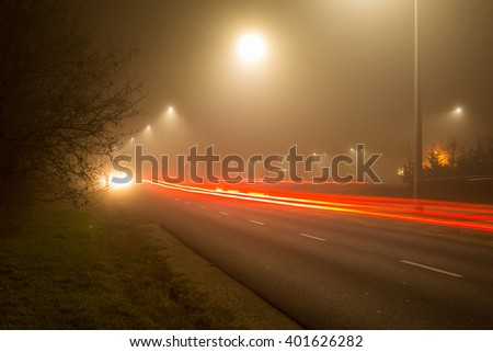 Night lights on the road at winter - stock photo