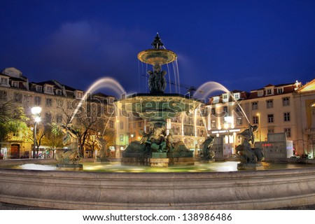 Night-lit fountain in Rossio Square, Lisbon, Portugal - stock photo