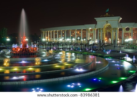 Night long exposure image of big fountain in National Park of first President of Almaty, Kazakhstan - stock photo