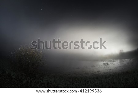 night over the lake, a dense fog over the lake, fog lights illuminated the city, a magic atmosphere, fisheye photo, water surface, the light from the lantern, blue toning, cloud over the earth, art - stock photo