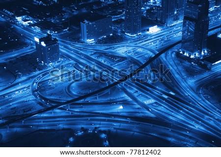 Night Panorama of Dubai. Transport road junction. - stock photo