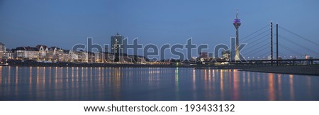 Night panorama of Dusseldorf with Rheinturm tower and Rheinkniebrucke Bridge - stock photo