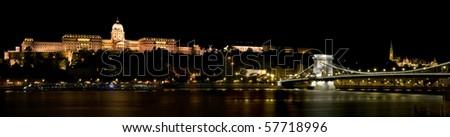 Night panorama of Royal Palace in Budapest (Buda Castle) and the Szechenyi Chain Bridge, Hungary - stock photo