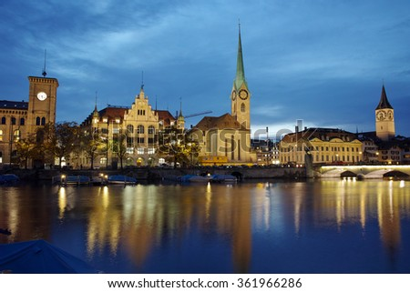 Night panoramic photo of city of Zurich and reflection in Limmat River, Switzerland - stock photo