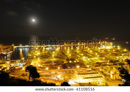 Night Panoramic view of containers in a harbour - stock photo