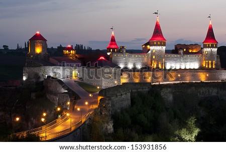 Night panoramic view of medieval half-ruined castle in Kamenetz-Podolsk, Ukraine - stock photo