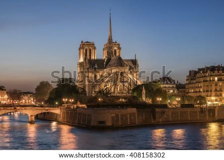 Night panoramic view to Cite island with Notre-Dame de Paris - stock photo
