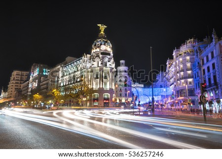 Night photography of Madrid cityscape, Gran Via street with rays of traffic light. Madrid, Spain.
