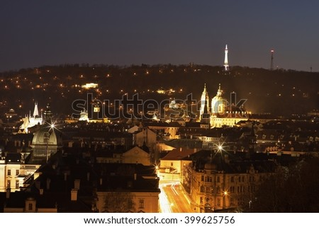 Night Picture of the old part of Prague, capitol of Czech Republic. Quarter called Small side under Prague castle and Petrin hill. Oldest part of city with historic buildings churches and tower on top - stock photo