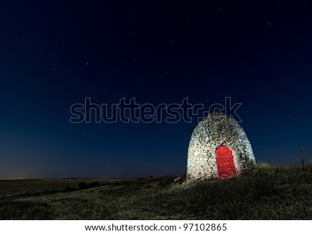 Night picture painting with light of a hut located in Albacete (Spain)