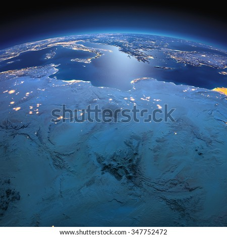 Night planet Earth with precise detailed relief and city lights illuminated by moonlight. North Africa. Libya and the Mediterranean Sea. Elements of this image furnished by NASA - stock photo