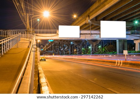 Night road long exposure with blank billboard for advertisement in Bangkok Thailand