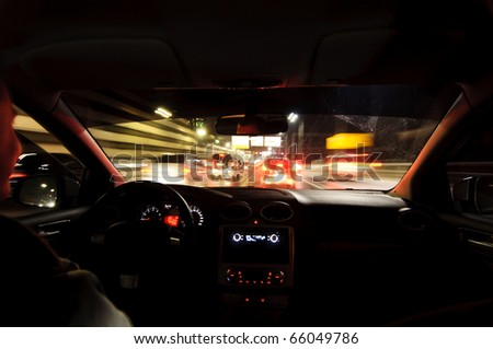 Night road. View from inside car. Natural light. Street and other cars is motion blurred. - stock photo