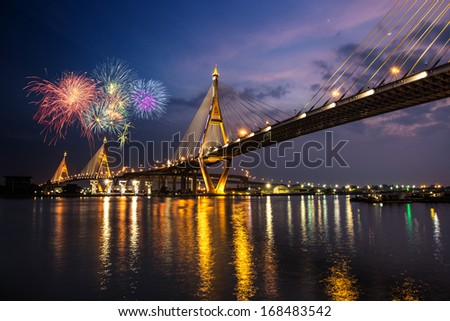 Night Scene Bhumibol Bridge with fireworks, Bangkok, Thailand - stock photo