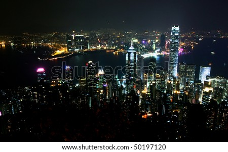 Night scene in Hong Kong Island and Kowloon side - stock photo