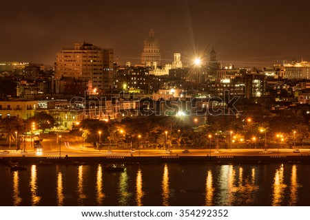Night scene in Old Havana with a view of the bay and the Capitol building - stock photo