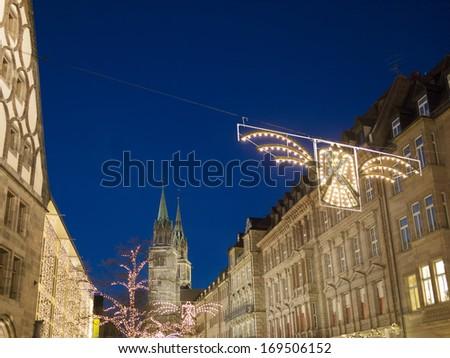 Night scene Nuremberg with Lorenz church Germany in December - stock photo