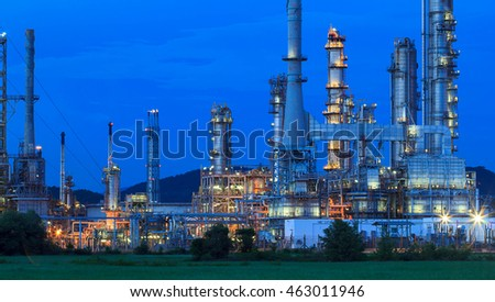 Night scene of detail of a heavy Chemical Industrial plant with refinery of pipes in twilight
