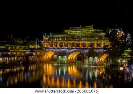 night scene of Fenghuang (Phoenix) ancient town Hunan China - stock photo