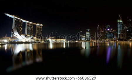 Night scene of financial district, Singapore From the river - stock photo