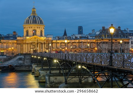 night scene of French institute and the pont des arts - stock photo