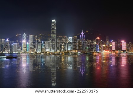 Night scene of Hong Kong with reflection on the sea - stock photo