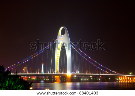 Night scene of Liede bridge with brilliant spot light in Guangzhou city of China - stock photo