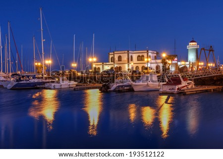 Night scene of Marina Rubicon, a small port along the Playa Blanca coast on Lanzarote Island of the Canaries Archipelago, Spain. - stock photo