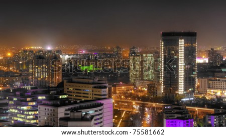 Night scene of modern city, standing from the suburb area and looking at the downtown - stock photo
