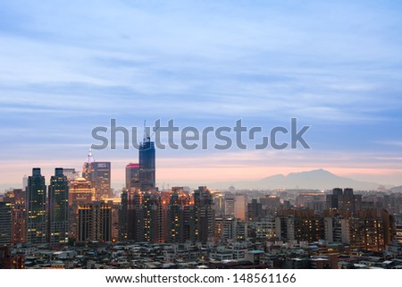 Night scene of modern city under blue and dramatic sky in Taipei, Taiwan, Asia.