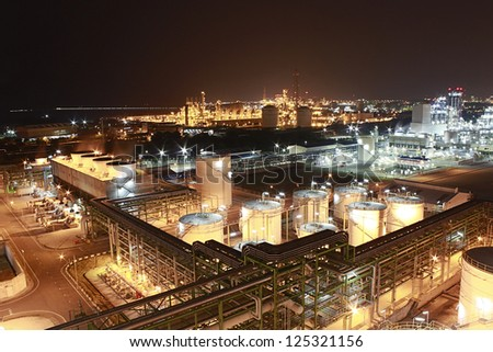 Night scene of petrochemical factory - stock photo
