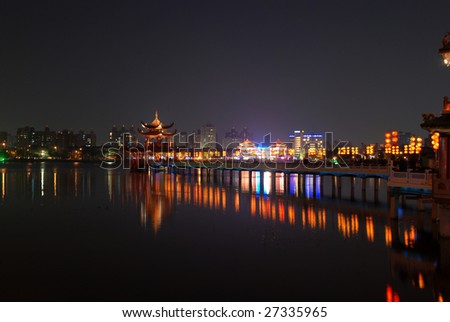 Night scene of temple and bridge - stock photo