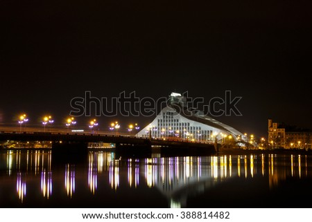 Night scene of the bridge and the National Library of Riga.