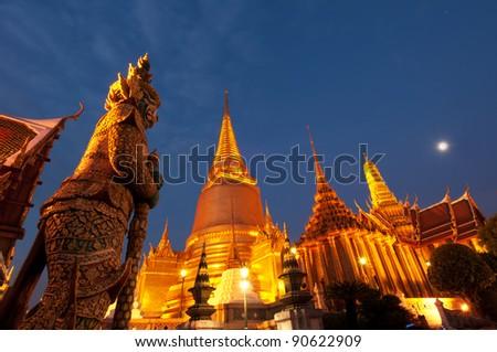 Night Scene of Wat Phra Kaew's Pagodas From the Grand Palace of Thailand - stock photo