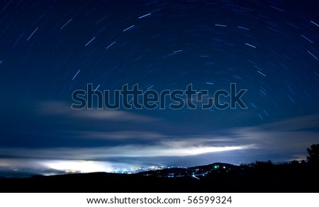 Night scene - stars movement, long exposure shot with low ISO - stock photo
