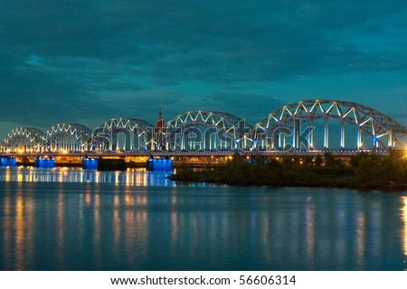 Night scene with city river and sky in  Riga - stock photo