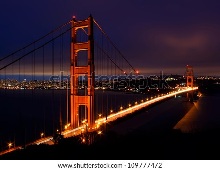 Night scene with Golden Gate Bridge and San Francisco lights in far background