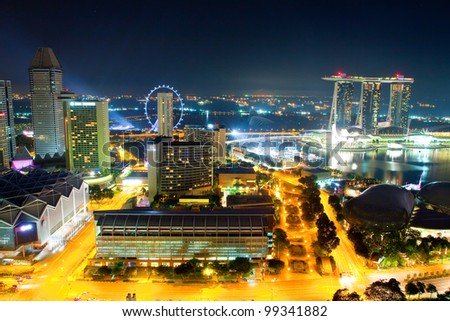 Night Scenery of Singapore with a Ferris wheel - stock photo