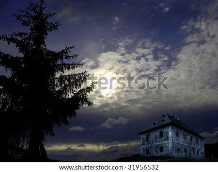 Night scenery with big tree, mysterious house and full moon - stock photo