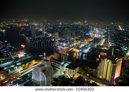 Night shot of a city skyline. Bangkok Thailand. - stock photo