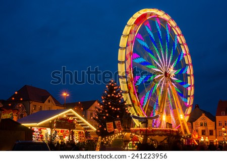 Night shot of a ferris wheel in christmas market, Cottbus, Germany - stock photo