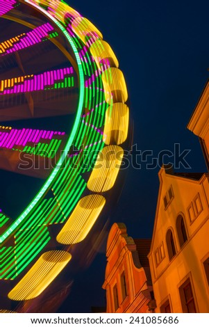 Night shot of a ferris wheel in Cottbus  christmas market - stock photo