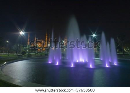 Night shot of the Blue Mosque with lit fountain waterworks in Istanbul, Turkey