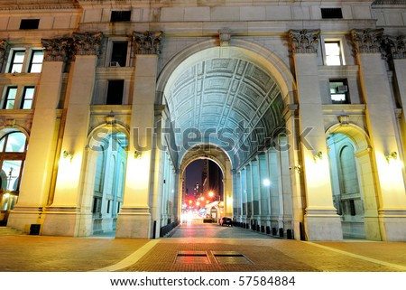 Night shot of the passage way through the center of the Municipal building. - stock photo