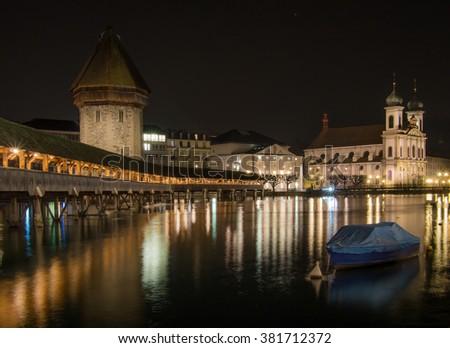 Night shot the of Chapel Bridge in City of Lucern, Switzerland - stock photo
