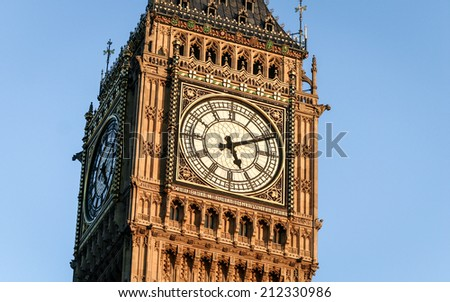 Night shot with close detail on the face of the iconic London landmark, the clock tower familiarly known as Big Ben. - stock photo