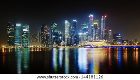 Night Singapore skyscrapers shines with electric lights - stock photo