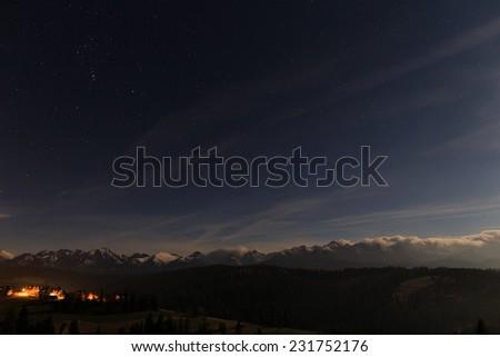 Night sky overt Tatra mountains - stock photo