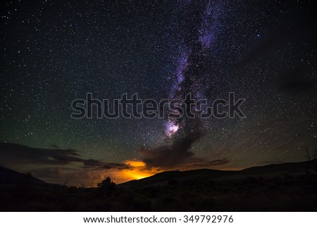 Night sky with beautiful milky way and lightning storm in the clouds - stock photo
