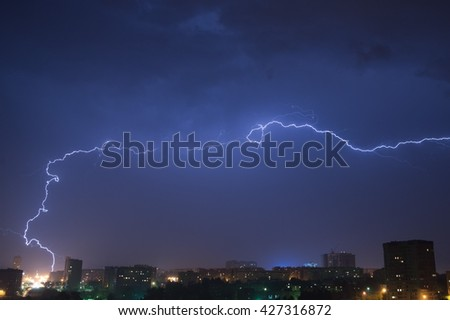 Night sky with lightning over the city